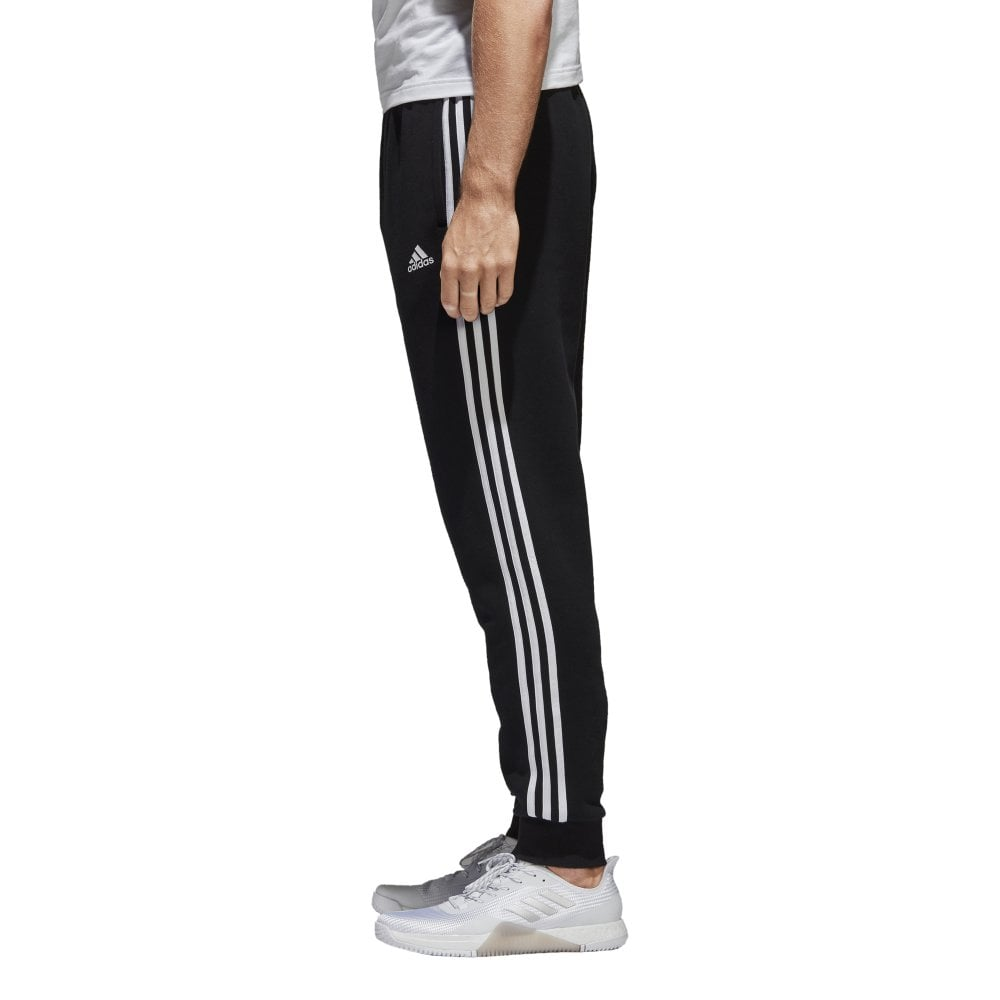 56b915fc953b adidas Men s Essentials 3 Stripes Tapered Fleece Pants